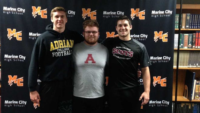 Marine City football players Justin Wiseman, Logan Brinley and Justin Headlee recently signed with colleges.