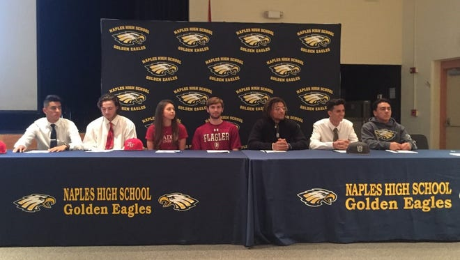 Seven Naples High School seniors sign letters of intent to play their sports in college during a ceremony in the school's auditorium on Friday, May 11, 2018.