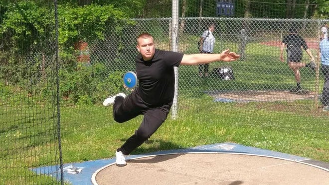 Middlesex's Matt Semon throws the discus in a recent practice.