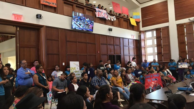 Hundreds of Guahan Academy Charter School supporters listen at a public hearing regarding the school on May 21, 2018.
