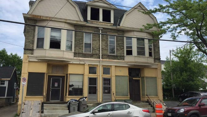A historic former grocery on Milwaukee's east side is being converted into six high-end apartments.