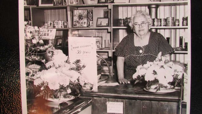 Mamie  Fredericks celebrates  her 50 years in  business on Macopin Road in  West  Milford  in the 1950s. She had a soda fountain and made ice cream treats in her general store  where she also sold groceries and other household supplies.