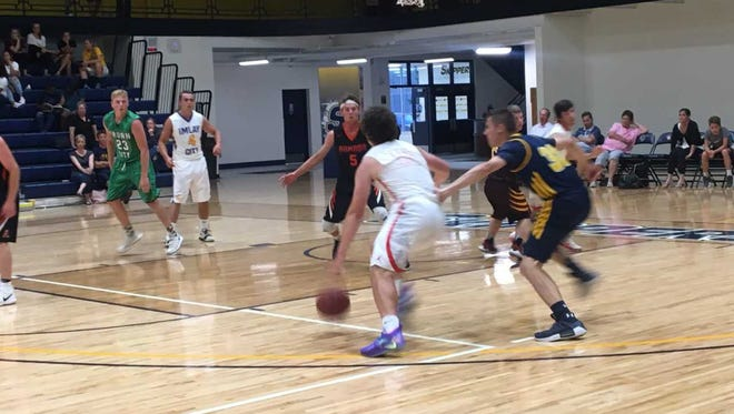 St. Clair graduate Ben Davidson drives down the lane during the St. Clair County Community College Blue Water Area All-Star Basketball Game.