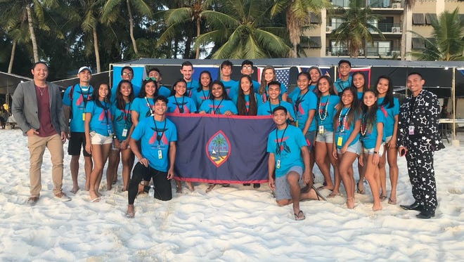 Guam's track and field contingent to the Micronesia Championships in Saipan, took home dozens of medals including 41 gold. They are pictured with team coach Mike Herreros and team manager Peter Rivera.
