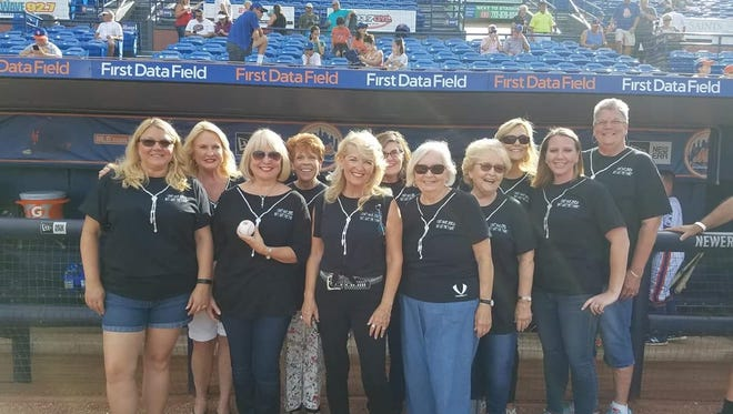 From left, Kathy Post, Gail Flesche, Sydney Liebman, Linda Evans, Maria Seidel, Pam Tempone, Cris Adams, Pat Alley, Veronica Tempone, Jennifer Wiggins, and Deejay Gardner raise money for HANDS at the June 14 St. Lucie Mets game.