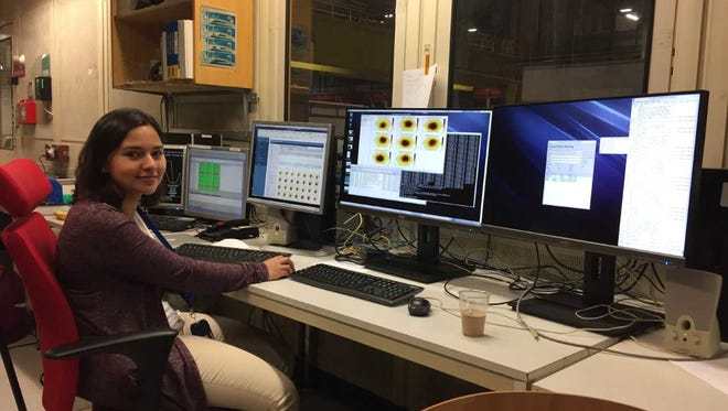 Hend Kordy takes a midnight shift collecting data during beam tests of the prototype modules at CERN.