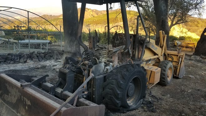 The Thomas Fire rendered this skiploader used by students in the Santa Paula High farm program a total loss.