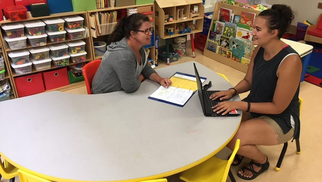Lead-Deadwood Elementary School special education teachers Jennifer Wetz, left, and Dana Schubauer go over lesson plans for summer school. Recent pay raises for South Dakota teachers have enabled school districts to attract more applicants, but some rural districts say they are still struggling.