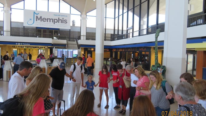 The Memphis team gathers in prayer at Memphis International Airport before leaving to assist at the Humanitarian Respite Center in McAllen, Texas