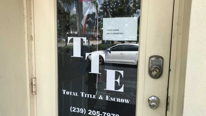 """The front door of Total Title & Escrow at 4410 SE 16th Place in Cape Coral displays a sign that says """"OFFICE CLOSED DUE TO EMERGENCY."""""""