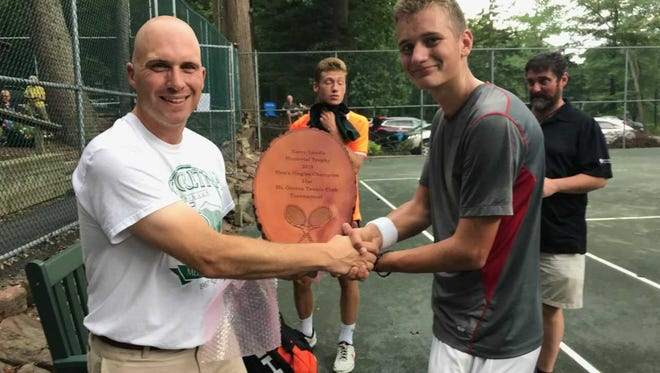 Ben Clary, right, accepts congratulations from tournament director Mike Rohrbach after winning his first Mt. Gretna singles title on Friday night.
