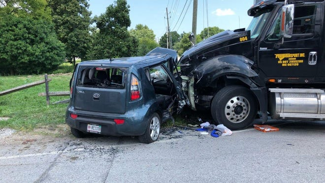 A semi truck and car crash in head-on collision, sending a 12-year-old boy sitting in the car passenger seat to the hospital with serious injuries.