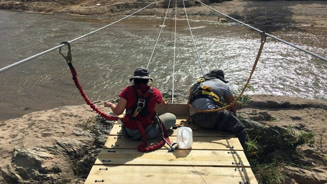 Volunteers from New Mexico State University's Aggies Without Limits student organization built a suspended pedestrian bridge in Utuado, Puerto Rico this summer as a service project.