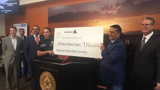 El Paso police Chief Greg Allen, left, and city Rep. Henry Rivera on Tuesday accept a $110,000 donation for body cameras.