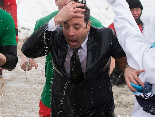 """The Tonight Show"" host Jimmy Fallon exits the water during the Chicago Polar Plunge on March 2 in Chicago. Fallon joined Mayor Rahm Emanuel for the event."