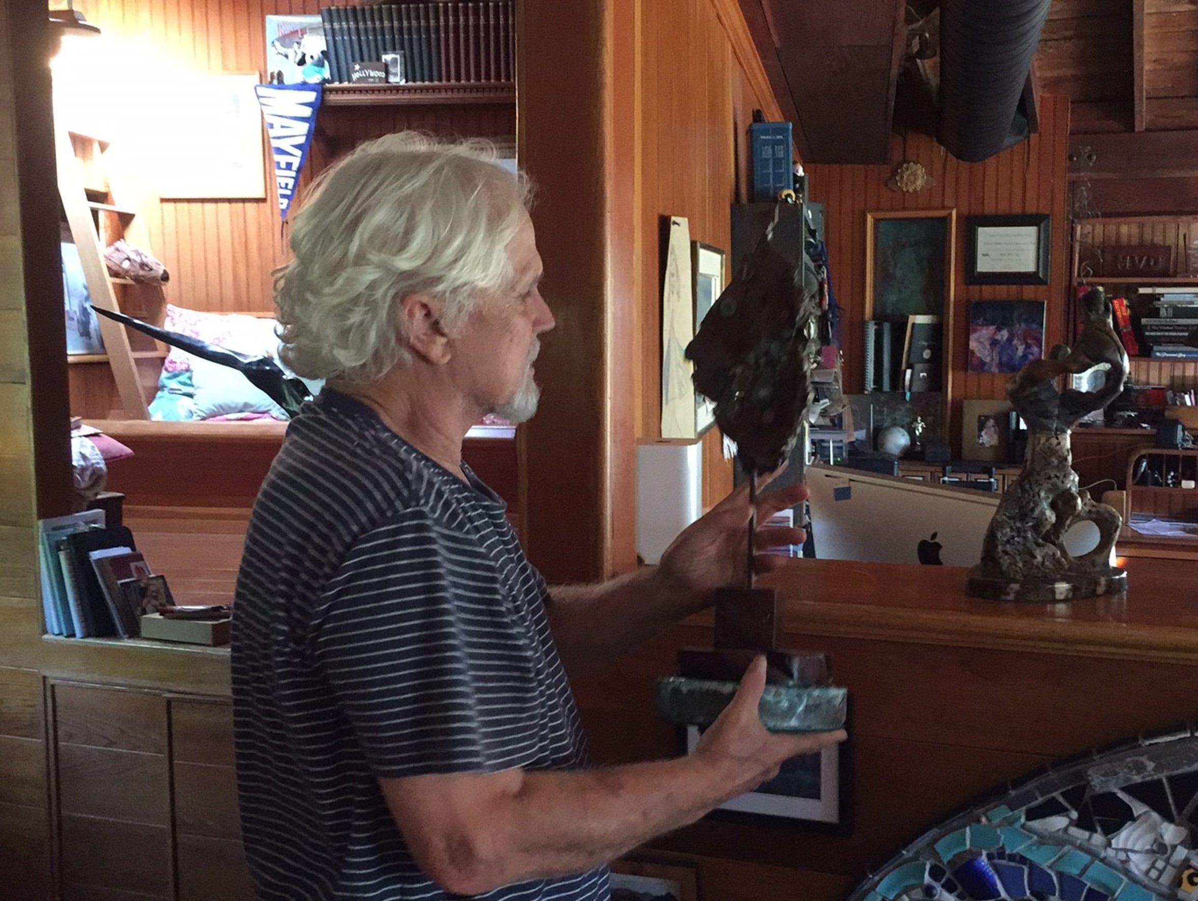 Tony Dow shows an Arizona Republic reporter around