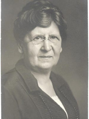 """Today's photo is of  Mrs. L. P. Brock.  The county park west of Ionia is named in her honor, BERTHA BROCK PARK.  Bertha Milligan was  a graduate of the Class of 1879 of Ionia High School and at an early age became a prominent historian concerning the Ionia area.  She gives the following account of the arrival of the Dexter party founding Ionia on the morning of May 28, 1833:  """"After purchasing wigwams from the Indians, the colonists were called together and a service of prayer and thanksgiving was held because of safe arrival after which the sides of the wagons were made into the first extension tables in this part of Michigan and dinner was spread.  Mrs. L. P. Brock."""""""