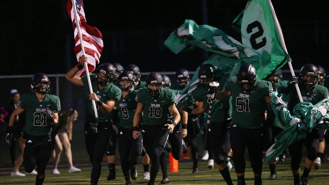 The Sheldon Irish take the field for their game against Jesuit. [Chris Pietsch/The Register-Guard] - registerguard.com