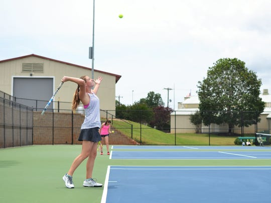 Carlin Corish, 12, serves the ball in a tennis match Saturday. Corish played in a 12U singles match in the 2017 Palmetto Championships at the Anderson University Athletic Campus.