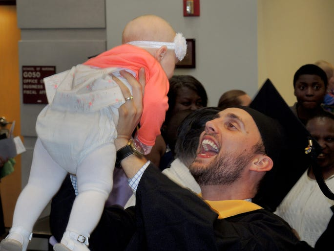 """""""Jonathan Sperry celebrates receiving his master's hood in nurse anesthesia at the University of Kansas Medical Center."""""""