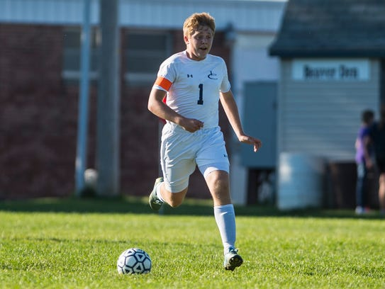 Lebanon Catholic's Nickolas Hartman brings the ball