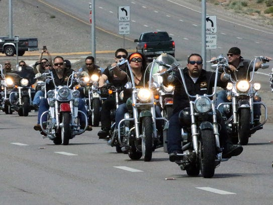 A long motorcycle procession rolls along Montana Ave