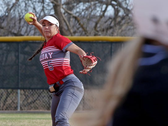 Holliday's Bree Zellers throws to first against City