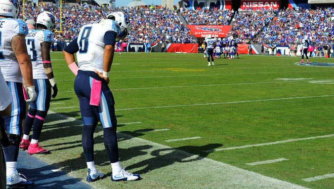 Mariota waits on the sideline in the fourth quarter against the Bills, who rallied for a 14-13 victory.