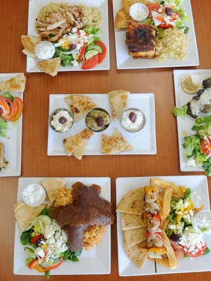 All kinds of different food plate at the Greek Cuisine in Camarillo. Order at the counter, food brought to table.
