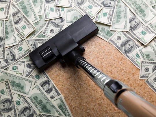 Vacuum Up Money On The Floor Getty