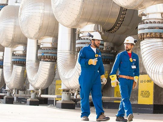 An image of two Exxon Mobil employees.