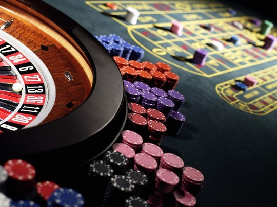 Casino chips on a roulette table.