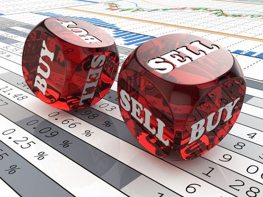 buy-sell-dice-on-financial-graph-stock-market-getty_large.jpg
