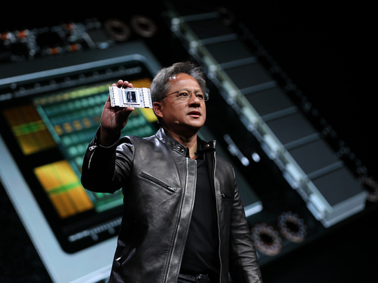 NVIDIA CEO Jensen Huang showing off the Volta GPU