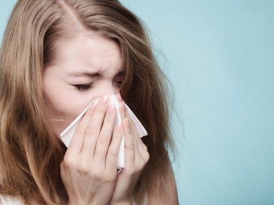 woman-sneezing_gettyimages-538144183_large.jpg