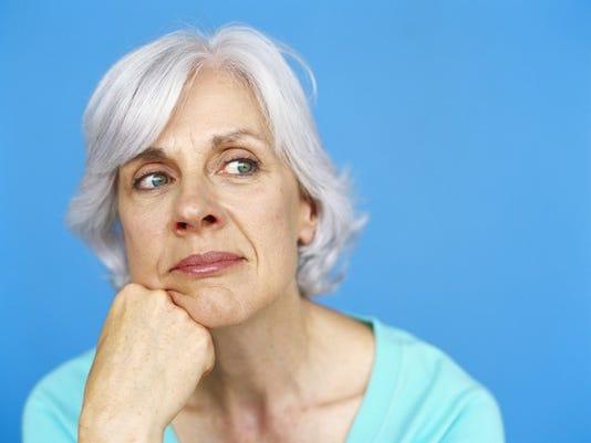 senior-woman-thinking-blue-background_large.jpg