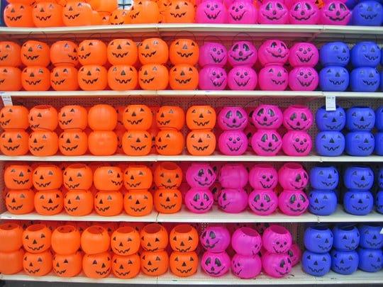 A wall of plastic jack-o-lanterns