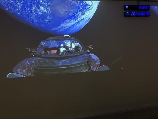 tesla-in-orbit-is-elon-musk_large.jpg
