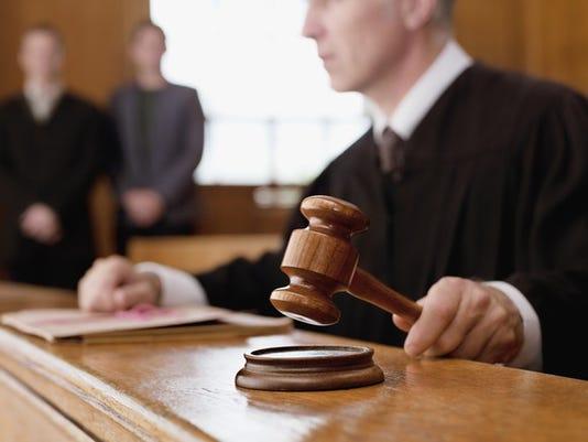 getty-judge-holding-gavel_large.jpg