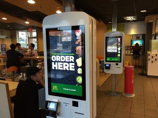 McDonald's self-serve kiosks in a restaurant