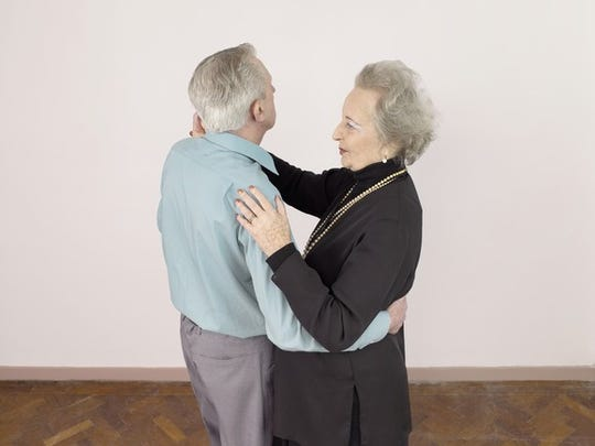 Senior man and woman dancing