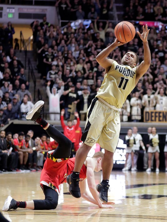 Purdue guard P.J. Thompson (11) shoots after being fouled by Maryland guard Kevin Huerter (4) during the second half of an NCAA college basketball game in West Lafayette, Ind., Wednesday, Jan. 31, 2018. Purdue defeated Maryland 75-67. (AP Photo/Michael Conroy)