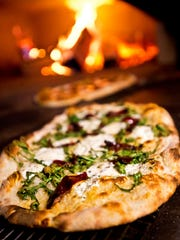 A wood-fired oven at Waterworks is a constant source of savory smells and aromas of baking naan and flatbreads.
