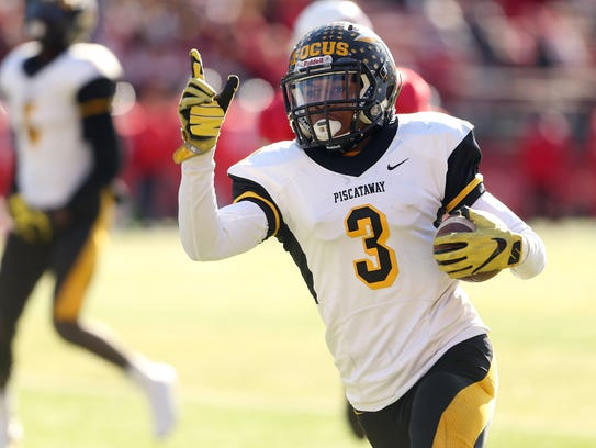 Piscataway's Devin Higgins celebrates as he heads to