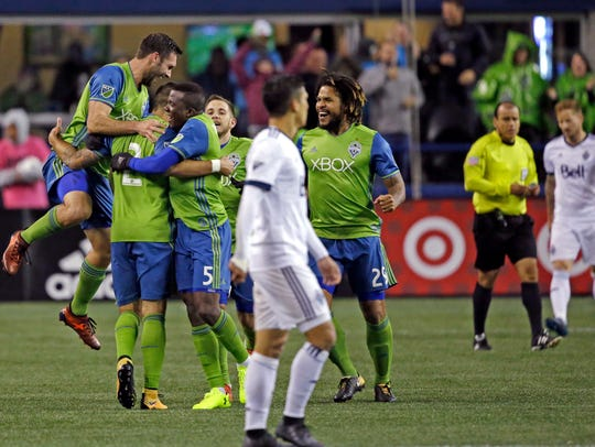 Seattle Sounders players celebrate a Clint Dempsey