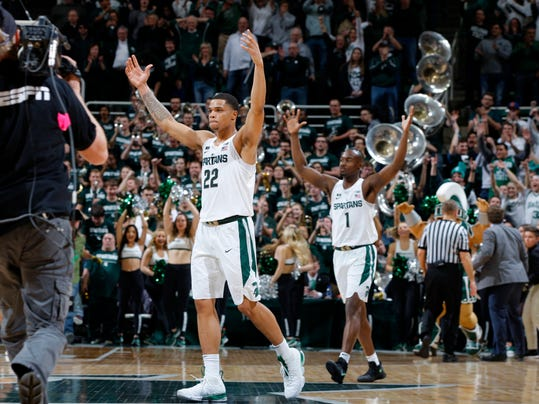 Michigan State's Miles Bridges (22) and Joshua Langford (1) celebrate following a 68-65 win over Purdue in an NCAA college basketball game, Saturday, Feb. 10, 2018, in East Lansing, Mich. (AP Photo/Al Goldis)
