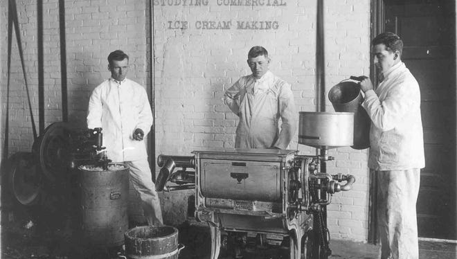 Students make ice cream in the SDSU creamery in the 1920s.