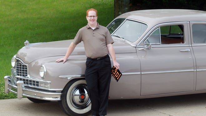 """Eric Hansford with his 1949 Packard that was driven by actress Cate Blanchett during the filming of the movie """"Carol."""""""