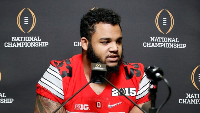 Ohio State's Michael Bennett responds to questions during media day for the NCAA college football playoff championship on Jan. 10, 2015. Bennett had a formal NFL combine interview with the Detroit Lions on Friday.