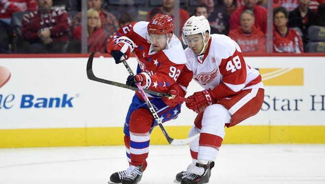 Washington Capitals center Evgeny Kuznetsov battles for the puck against Detroit Red Wings defenseman Ryan Sproul (48) on Nov. 18, 2016, in Washington.